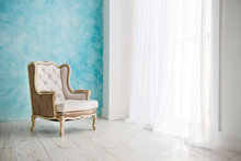 Vintage Armchair Against White Wall And Big Window With Curtain. Space For Your Copy