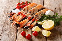 Preparation For Cooking Raw Langoustine, Scampi With Vegetables, Herbs And Spices Close-up On A Board On A Wooden. Horizontal