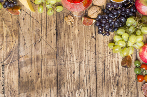In de dag Buffet, Bar Cheese, wine, baguette grapes figs honey and snacks on the rustic wooden table top with copy space.
