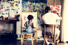 Artist Family Are Painting In The Living Room