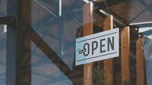 CU We Are Open Sign Hanging On The Entrance Door Of A Small Cafe. Small Business Concept