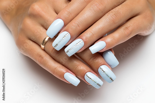Valokuva summer blue, heavenly nails with crystals on long square nails