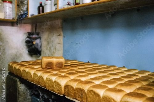 Photo Loafs of home made bread in a kitchen in India.