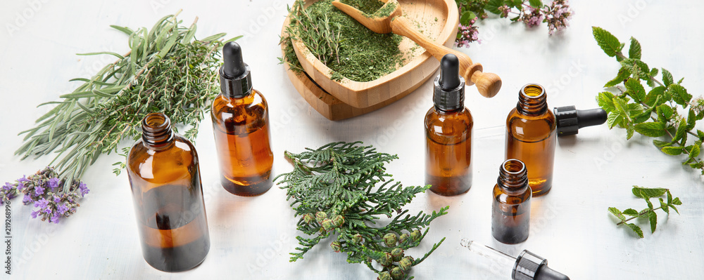 Fototapety, obrazy: Bottles of essential oils