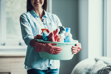 Young Happy Woman Holds Cleaning Equipment At Home