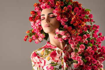luxurious woman with red roses flower, fashionable hairstyle