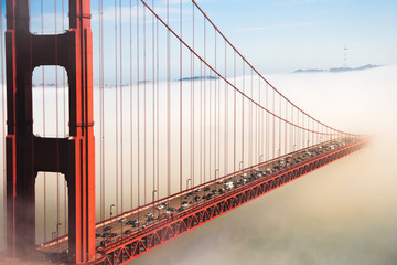 Overlook of the famous landmark the Golden Gate Bridge caught in the mist, San Francisco, California pacific coast, USA.