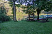Small Kayaks And Canoes Along Lake