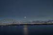 Night view on the illuminated riverside in Riga