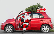 Authentic Santa Claus In Car With Gift Boxes And Christmas Tree, View From Outside