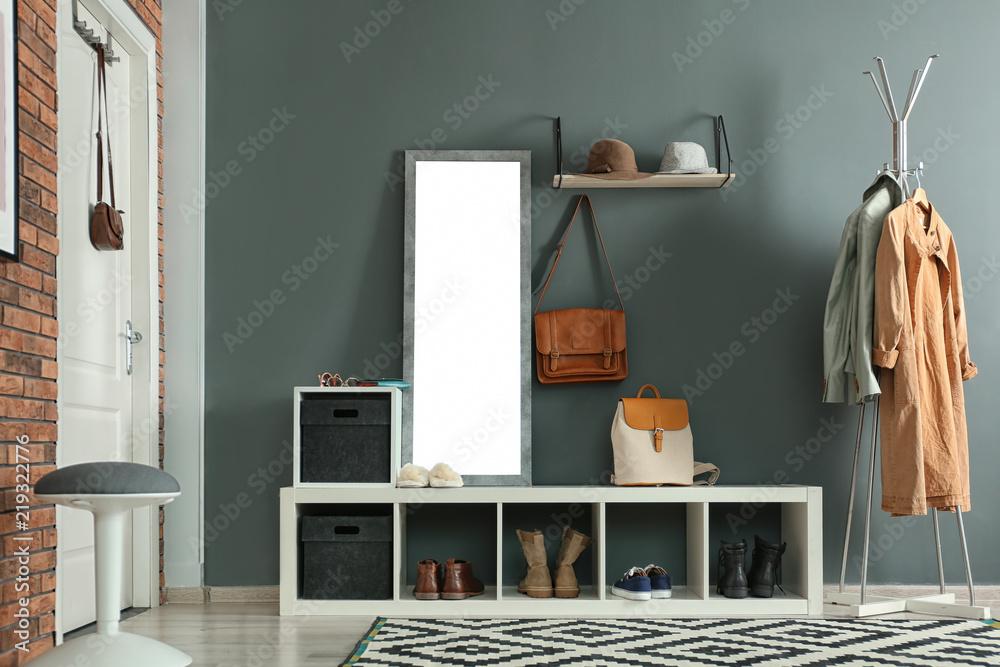 Fototapeta Stylish hallway interior with mirror and hanger stand