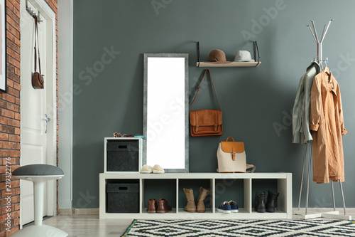 Fototapeta  Stylish hallway interior with mirror and hanger stand