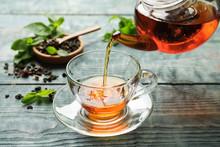 Pouring Black Tea Into Glass C...
