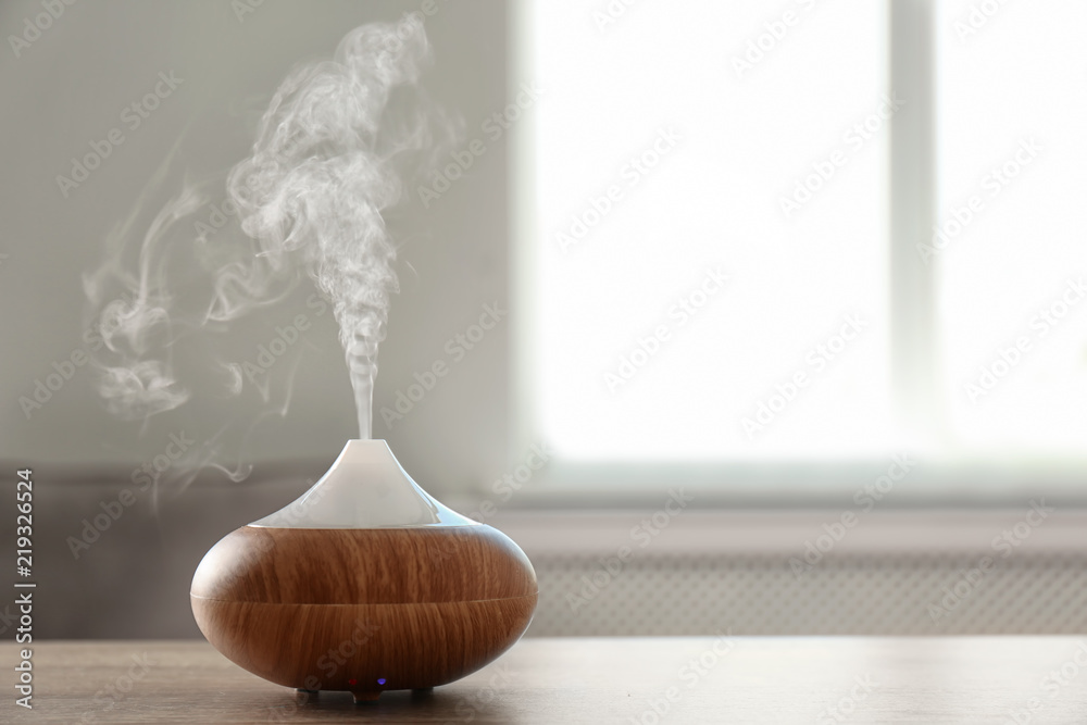 Fototapety, obrazy: Modern aroma lamp on table against blurred background with space for text