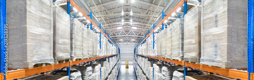 Spoed Foto op Canvas Industrial geb. Panorama of a modern newest huge distribution warehouse with high shelves and big ventilation pipes on the ceiling. Top view