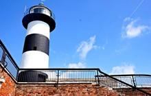 Lighthouse On Blue Sky