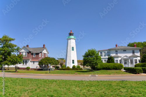 Old Point Comfort Lighthouse and keeper`s quarters in Fort Monroe, Chesapeake Bay, Virginia, USA.