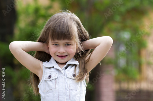 9895cfcc8 Portrait of a pretty little long-haired blond preschool child girl ...