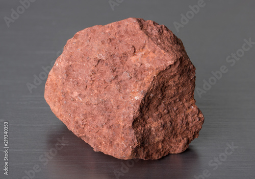 Specimen of mineral stone bauxite on gray background Canvas Print