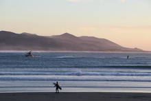 After Surfing, Lone Surfer On Beach