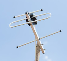 TV Antenna Aerial On The Roof Of The Sky And