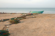 Small fishing boat in water next to fishing nets drying on Nilaveli beach in Trincomalee Sri Lanka Asia