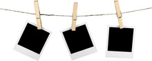 Three Blank Polaroid Frames Hanging On Twine Attached With