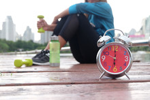 It's Time For You To Exercise. (Clock And Dumbbell, City Background)