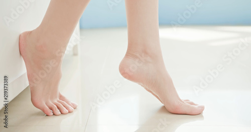 woman apply cream with foot Canvas Print