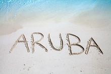 The Inscription Of Aruba On The Beach Of White Sand