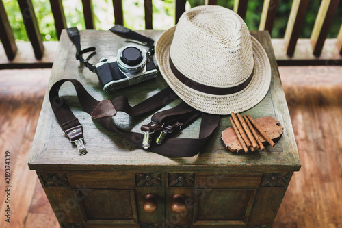 Male set: cigars, whiskey, hat, suspenders and camera on vintage a wooden table Canvas Print