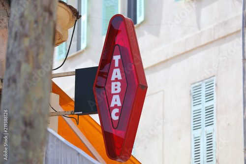 Cuadros en Lienzo French Red And White Modern Tabac Sign - Close Up View