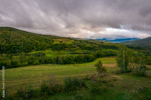 beautiful landscape in mountains. agricultural fields on hills. gloomy and overcast weather in autumn