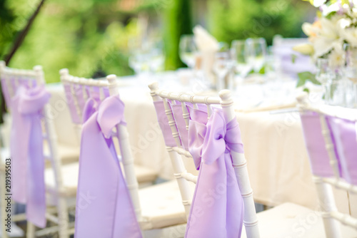 Fotografija Chair decoration with a ribbon for a special event/wedding