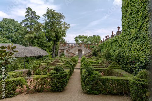 Staande foto Tuin Barcelona, Spain - May 10, 2018: The Garden of the Boixos in Labyrinth Park of Horta. The staircase with two busts in the background leads to the Desvalls Palace.