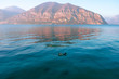 Beautiful minimalist landscape of Lake Iseo with emerald transparent water