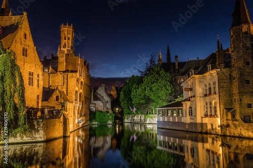 Reflections in canal in Bruges, Belgium during the night