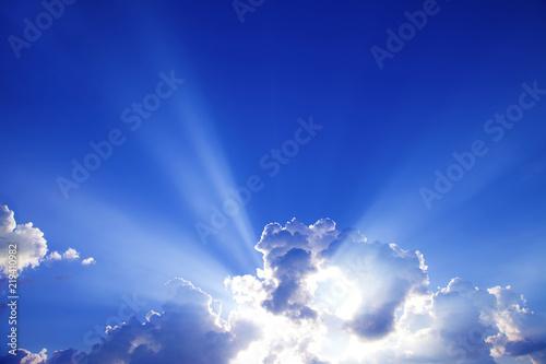 Foto auf Leinwand Dunkelblau sun rays with clouds on blue sky landscape.