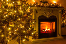 Happy New Year And Christmas. A Cozy Room Where A Fireplace Burns And There Is A Christmas Tree Decorated With Toys And A Garland
