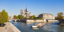 France, Paris, Notre Dame Cathedral And Fright Ship On Seine River