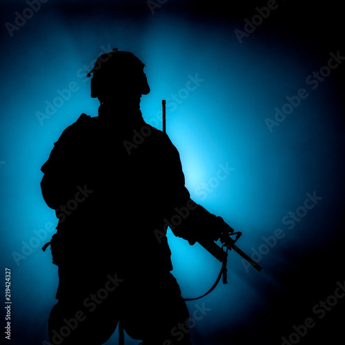 Slika na platnu Silhouette of modern infantry soldier, elite army fighter in tactical ammunition