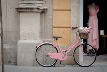 Pink Bicycle In Front Of A Pink Dress