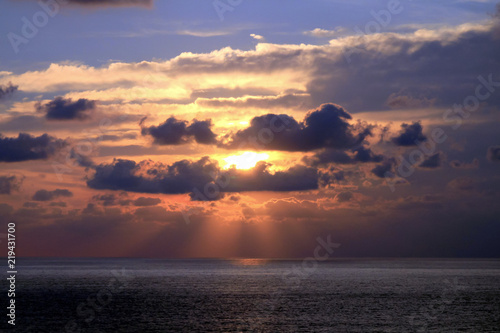 Fényképezés  Sunset and Sunbeams through Tropical Clouds Formation over Acapulco Bay