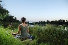 Yogin Girl Sits In A Meditativ...