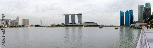 Fotografie, Obraz SINGAPORE - 17 Jul 2014: the Marina Bay and Central Business district appear as a skyline in this panorama view of central Singapore
