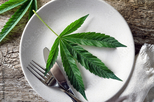 Tuinposter Kruiderij Cannabis Leaf on Plate