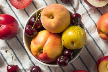 Naklejka na ściany i meble Raw Organic Assorted Stonefruit Peaches