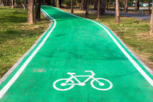 Empty Green Cycle Track With Bike Lane Sign In Park