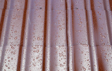 Fragment The Wet Brown Metal Roof Of The House In The Form Of Roof Tiles With Many Drops After The Rain, Top View Close Up