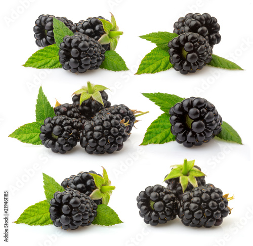 Set of ripe blackberries with green leaves isolated on white